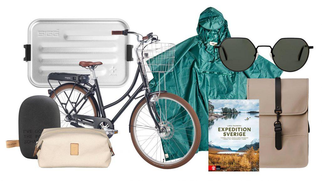 Powerbank, elcykel, regnponcho och solglasögon för staycation med upptäcktsfärd