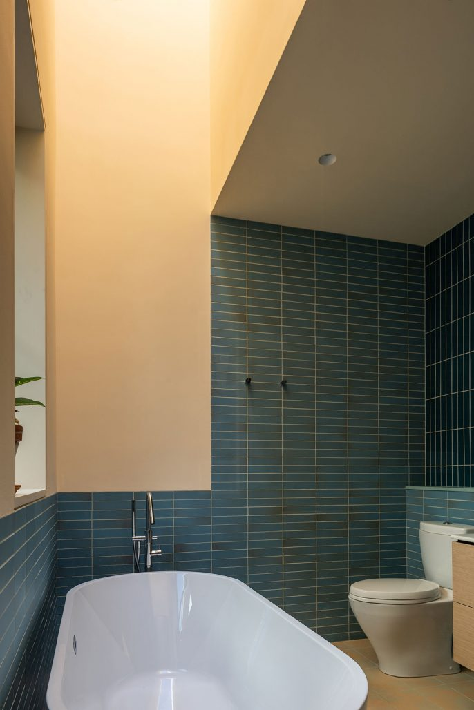 Grönt kakel i badrummet